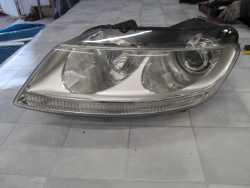VW PHAETON REFLEKTOR LAMPA XENON LEWY 02/10